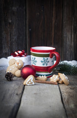 Mulled wine and Christmas decorations on vintage wooden table