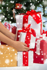 close up of woman with gifts and christmas tree
