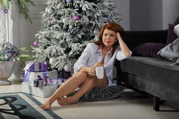 girl with gifts around the Christmas tree