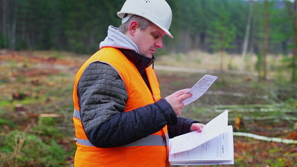 Forest engineer destroying sensitive documents in the forest