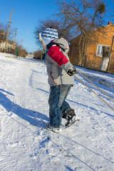 Boy pulls sled
