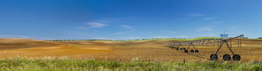 Panorama view of a industrial irrigation equipment on a field.