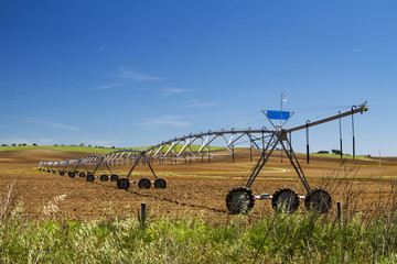 View of a industrial irrigation equipment on a field.