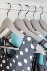 row of dress hanging on coat hanger