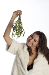Woman holding bunch of Mistletoe a Christmas tradition