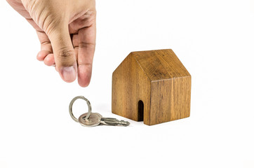 hand try to pick up key with wodden house model