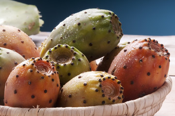 colored prickly pear in a basket