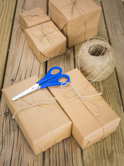 string and brown paper parcels with scissors and string