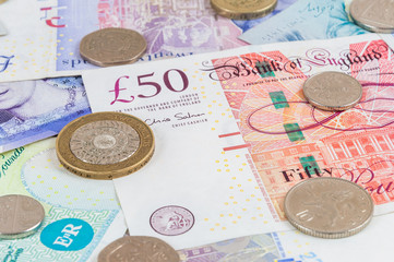 British pounds banknotes and coins background