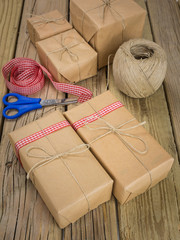 string and brown paper parcels with scissors, ribbon  and string