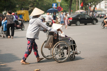 Wheelchair on street in Hanoi,Vietnam.