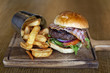 Tasty big burger with chips - 74506368
