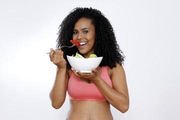 Brunette woman eating salad