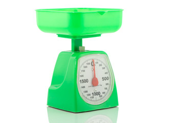 Green kitchen weighing scale on a white background
