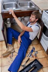Tired handyman at work