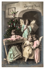 lovely kids with white angels wings and christmas tree