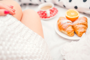 breakfast in bed, coffee and milk, snacks and croissants