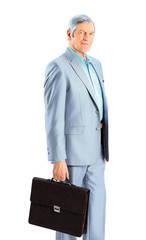 Nice businessman at the age, with a portfolio of.