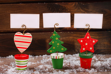 three christmas greeting card holders on wooden table