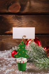 christmas greeting card holder on wooden table