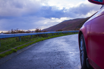 A Red Car on A Mountain Road