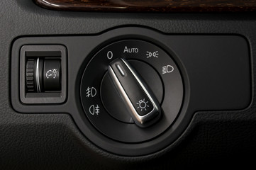 Modern car headlight controls. Automobile interior detail.