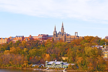 Georgetown University buildings in fall along the Potomac River