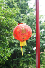 Red chinese lantern on green bokeh background