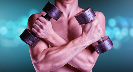 Strong muscular man with dumbbells