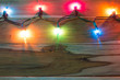 Christmas lights on wood For background.