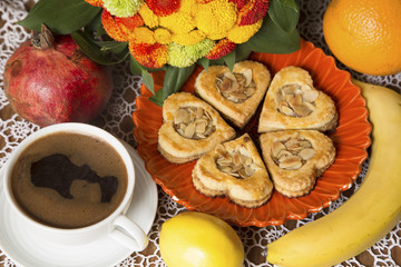 Biscuits, fruit and a cup of coffee