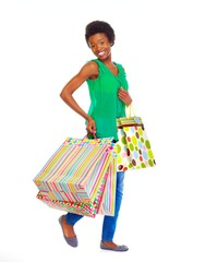 Beautiful african girl with shopping bags.
