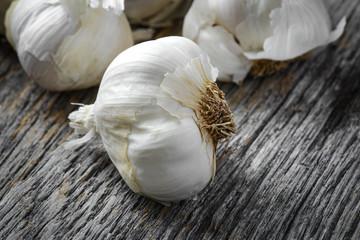 Garlic Bulb Close Up on Rustic Wood Background