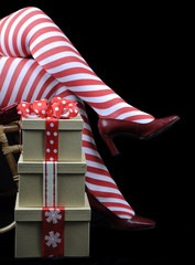 Lady Santa with red white candy cane stocking legs