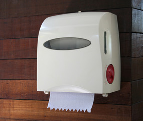 tissue box on the wall in the bathroom