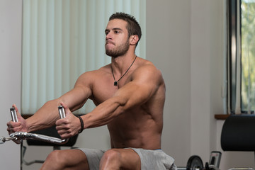Fitness Athlete Doing Heavy Weight Exercise For Back