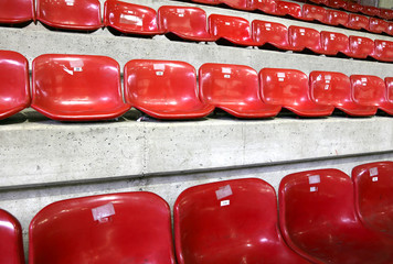 many red empty seats in the stadium