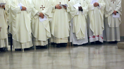 priest with the white cassock during the religious celebration