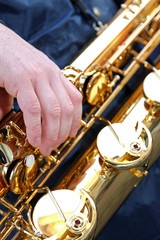 player's hand with the Golden saxophone