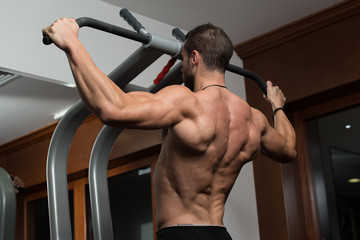Healthy Young Man Doing Exercise For Back