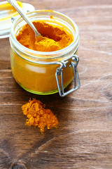 spice turmeric in a transparent jar