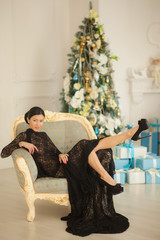 girl in black dress sitting in a chair