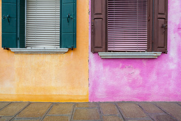 Windows on yellow and pink wall