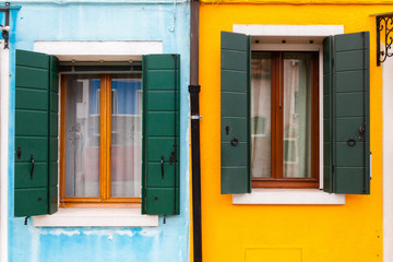 Colorful windows on yellow and blue wall
