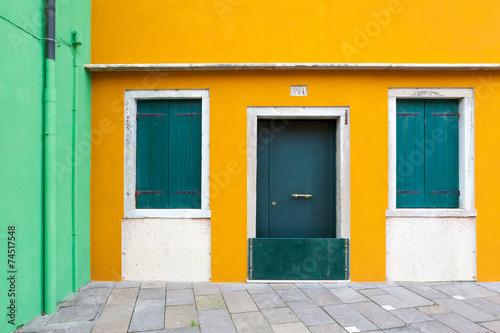 Colorful walls in Burano, Venice, Italy - 74517548