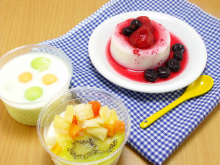 milk pudding dessert with strawberry and blue berry
