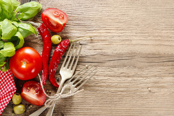 Italian cuisine background: tomatoes, olives and peppers