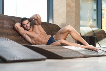 Young Man Lying On A Sun Lounger