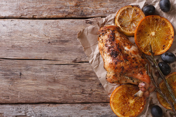 roasted rabbit leg with oranges and olives horizontal top view