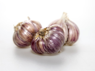 Three heads of garlic on a table